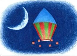 Um balão sobe no céu azul da noite fazendo companhia para a Lua.